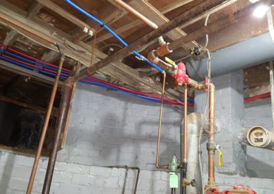 FOR SAFETY, INSTALL FIREPROOF SHEETROCK ON CEILING ABOVE BOILER.