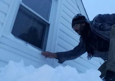 House Inspection In Snow Is Executed By a House inspector For Home Inspection Services