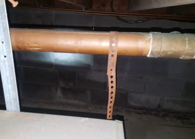 In Home Inspection Services Plumbing Inspection Performing On a Corrosion Basement Which Finds Out Broken Hangers In The Basement Of a House